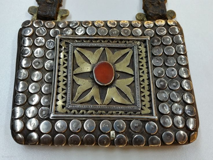 Centrial Asia Turkmen Amulet holder,Teke Silver fire gilded and chased whit applied decoration  silver beads and table-cut carnelian stone. Mounted on leather. Circa 1900