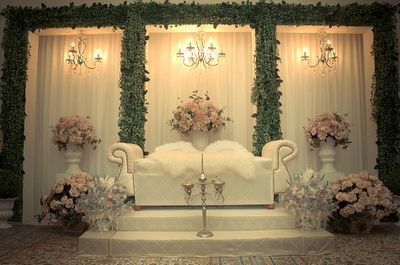 """Pelamin - Malay Wedding Style. The Bride & Groom sat on the chair for couple of hour & some VIP guest would come by to perform """"Tepung Tawar"""""""