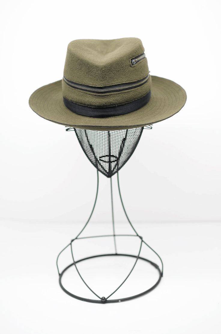 This Fedora hat is unisex .   Handmade on a wood block .  This crown is my original design handcrafted  from La Forme , Paris.   A two ways zip open the crown as a utility design to ventilate your head.  Height of the crown is 10 /11/9 cm  Brim is 7,5 cm all round with a fur hem stitch on the edge  This wool felt is made in USA