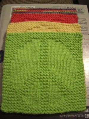 Peace Sign Dishcloth - surprisingly easy. make sure you use recommended needle size and knit tight, or go down a needle size if you don't want to worry about keeping it tight. I've made quite a few, still fun! -abi