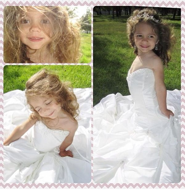 I took pictures of my daughter in my wedding dress. She is 3 years old. She felt like a princess.