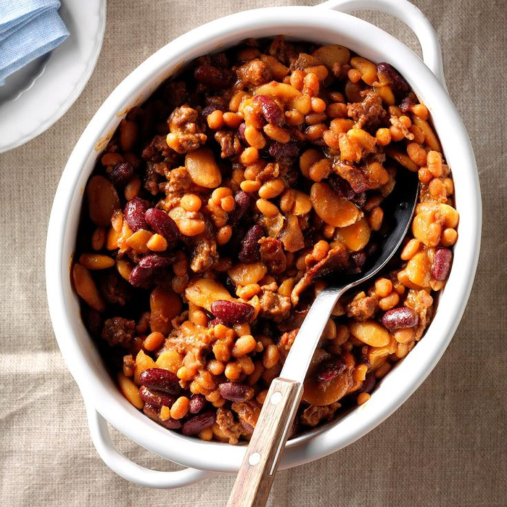 "Three-Bean Baked Beans Recipe -I got this recipe from an aunt and made a couple of changes to suit our tastes. With ground beef and bacon mixed in, these satisfying beans are a big hit at backyard barbecues and church picnics. I'm always asked to bring my ""special"" beans. —Julie Currington, Gahanna, Ohio"