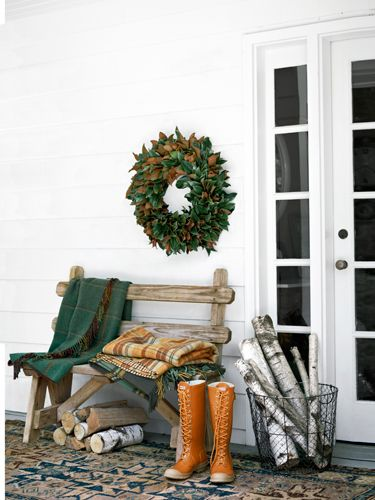 Warm up your patio this fall with throws, firewood, and a seasonal wreath.