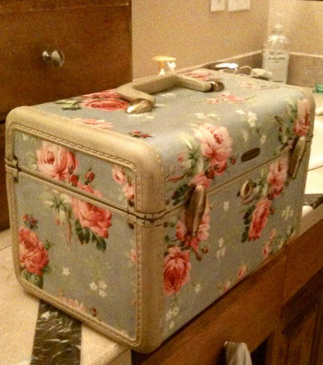 Vintage Train Case, with fabric glued on it with mod podge.