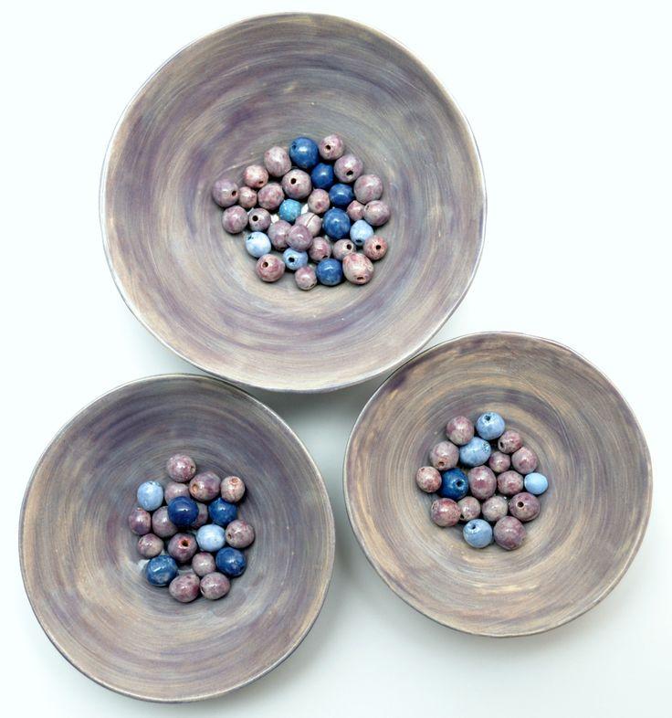 handmade beads in three bowls.
