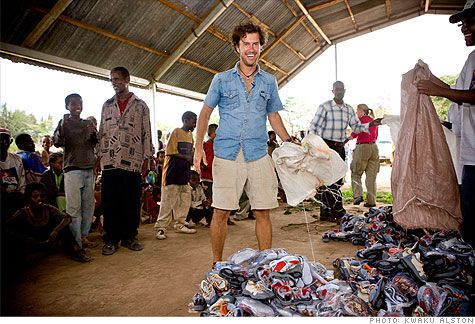 Blake Mycoskie, founder of Tom's shoes, in Ethiopia giving away shoes. Buy one and he give another pair away. Gotta love that!