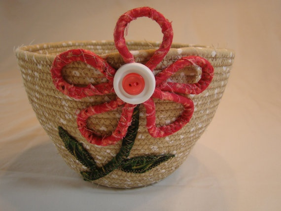 Cream and white fabric coiled bowl with rose
