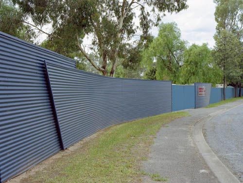 Continuous feature wall around Gawler Caravan Park using fencing made from COLORBOND® steel