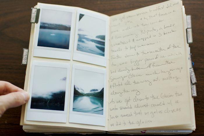 Polaroids in a journal.