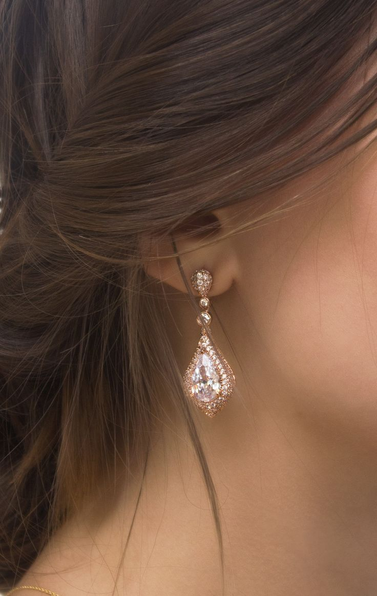 PRODUCT DETAILS - Cubic Zirconia Crystals - 18K Rose Gold Finish - Hypoallergenic, Lead & nickel free - H 1 1/2 in. x W 5/8 in. ITEM #E069-RG