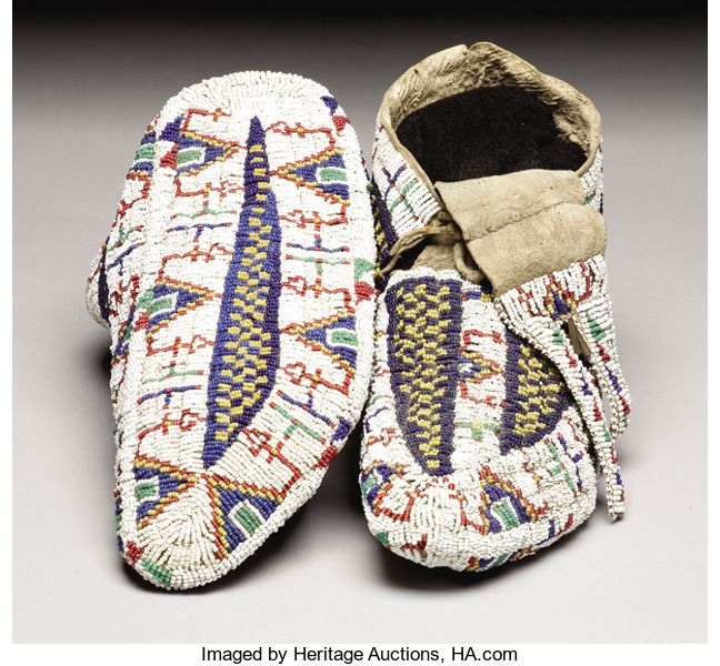 American Indian Art:Beadwork, A PAIR OF SIOUX BEADED HIDE CEREMONIAL MOCCASINS. c. 1885. ...(Total: 2 Pieces)