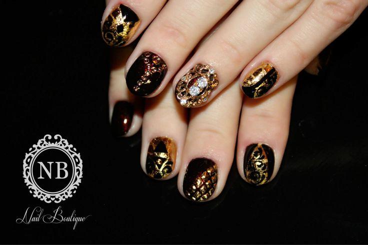 dark red nailpolish mixed with super nail jewlry