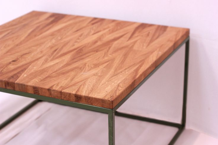 Oak coffe table  At the boarded rang change with the oak tree and we received interresting pattern so. The tree race and tha metal frame colour type according to your taste can be change. Size Width: 70 cm Depth: 70 cm Altitude: 45 cm