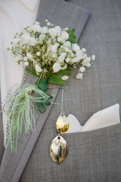 """Fishing lure boutonnieres that my husband had engraved for his groomsmen with """"Groomsman"""" and the date!"""