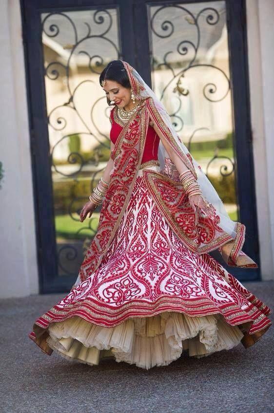 Elegant design Bridal saree in cream & pink designer work. Express true happiness. #lehenga #bride #pink #happy