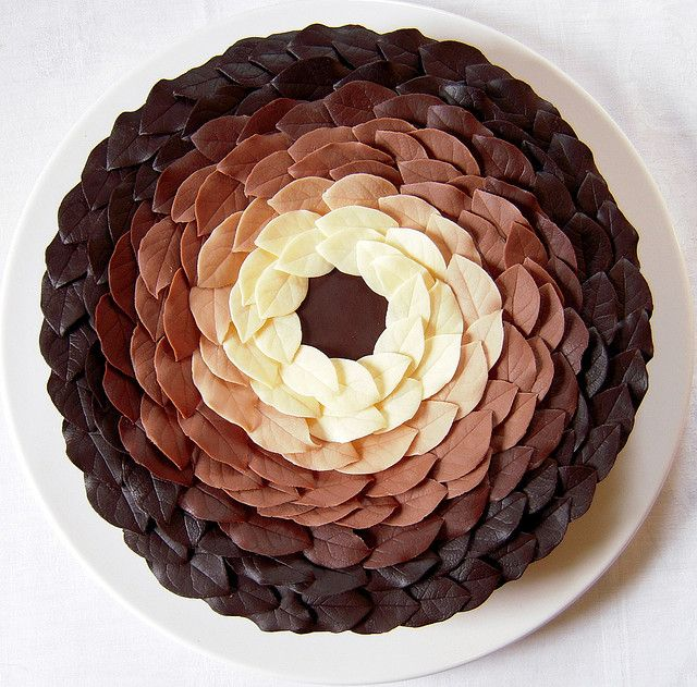 Chocolate Leaf Cake! White, milk and bittersweet chocolate leaves in concentric circles adorn a three-layer almond and coffee buttercream cake
