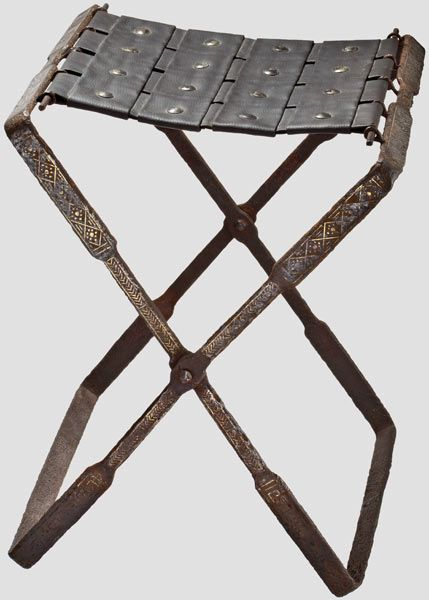 A late Roman iron folding chair with gold-damascening for high officials or military officers, 4th - 5th century   Dimensions when open ca. 50 x 39 x 37 cm. Dimensions of frames 59 x 36 and 59 x 38 cm