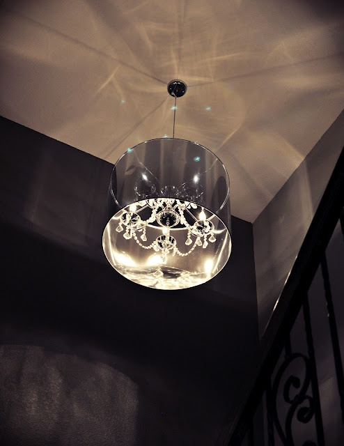 """This amazing pendant light from Z Gallerie that we placed in the stairway, is the perfect preview to what awaits upstairs in the master bedroom"" - @Nicole White"