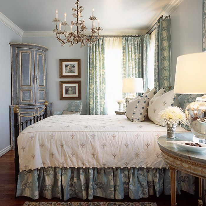 Such an elegant guest bedroom in pale blues with subtle patterns and textures