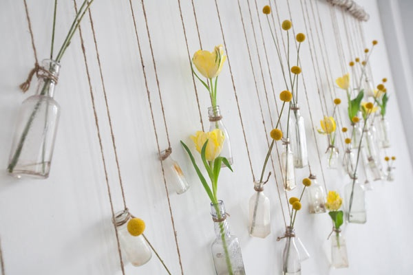 Spring flowers in hanging glass bottles - a simple idea to try at home