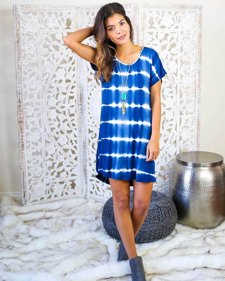 Rainstone Dress WWW.VICICOLLECTION.COM The tye dye dreams you have been dreaming of. Our Rainstone Dress is a simple and chic knot back tshirt dress that pairs beautifully with Fringe Forever Heels and Booties. Dress it up or down and layer with your favorite boho jewelry pieces. The beautiful tie die print comes in two rich earthy hues, Amber and Blue, and will wear beautifully from this season to the next. Kept simple in the front with a delicate laying twist in the back.