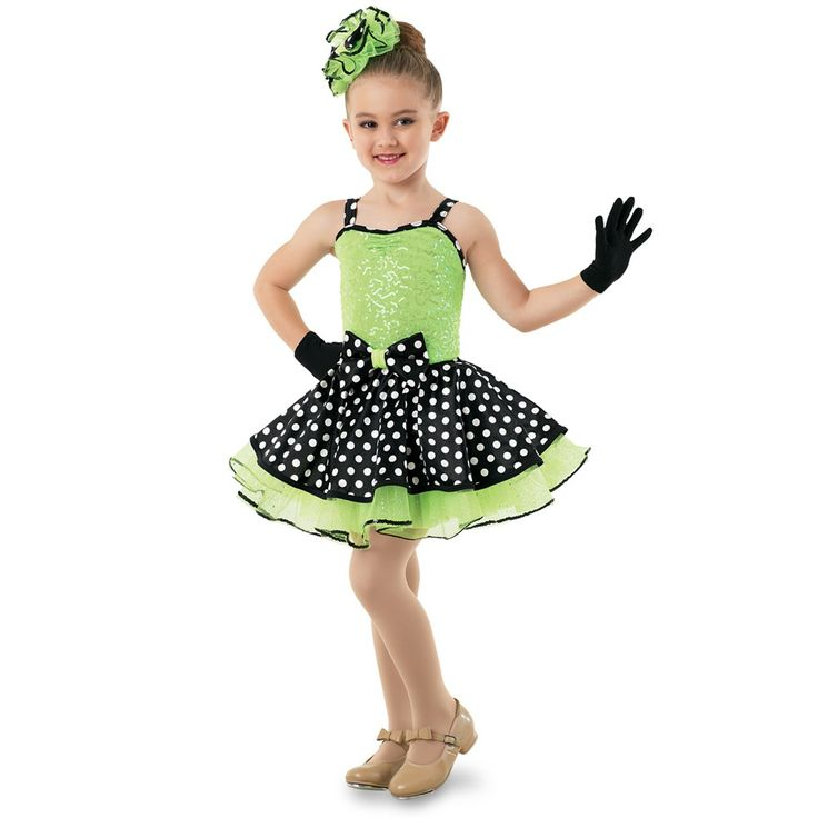 10041 The Shimmie Shake! - This standout style features a crystal sequin bodice with polka dot trim at the neckline and straps and bow at the waist. The polka dot top skirt is accented by a lime glitter tulle underskirt. Imported.  Includes : Hair pouf with bow accent; short gloves.
