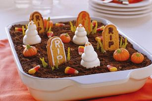 Ghosts in the Graveyard - Super-cute Cool Whip ghosts rise out of chocolate pudding topped with cookie crumbs.