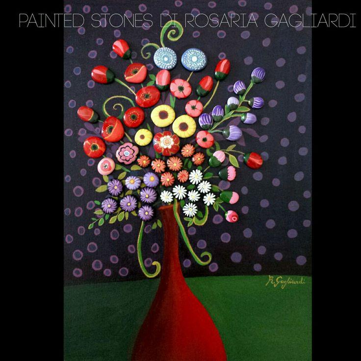 Vaso rosso con fiori di campo