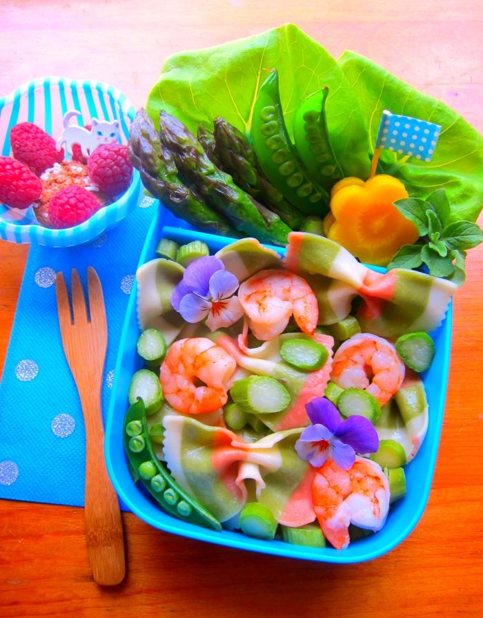 Jenn's pasta bento. Finalist. USA  This pasta primavera bento features pastel rainbow farfalle, sugar snap peas, asparagus and shrimp in an olive oil and lemon dressing, accented with pansies and a sprig of spicy oregano. Butter lettuce and flower-cut golden beets add additional notes of spring, with ripe raspberries and an amaretto cookie for a sweet finish. Thanks for hosting this event and bringing lovers of bento together for creative fun!