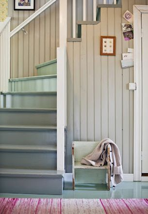 Love the soft colors, painted floor and stairs, tan beadboard.