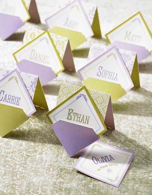 Pocket Escort Cards: I am really into these escort cards. They show the name and when you remove the card from the pocket, the table number (and sometimes meal choice) is revealed