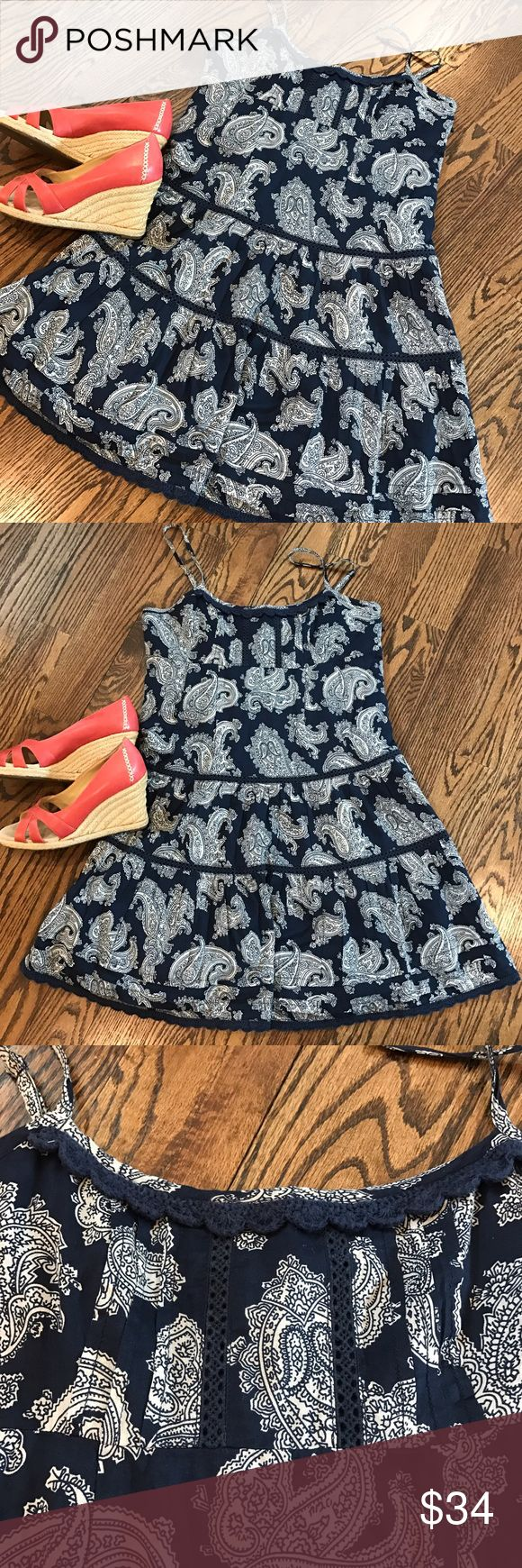 ⭐️New⭐️Navy paisley Juicy Couture patio dress This tiered patio dress from Juicy Couture has a navy & white paisley pattern with crocheted trim & inserts.  It is 100% cotton and fully lined.  It has a side zipper and adjustable straps.  Perfectly preppy. Size 4.  Very good used condition. Juicy Couture Dresses