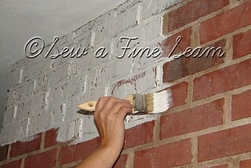 """Paint a brick fireplace : easy to follow and easy to do with 2 coats of primer. I Recommend using a 2"""" brush and painting each brick individually for a nicer look where the mortar can stand out instead of using a roller."""