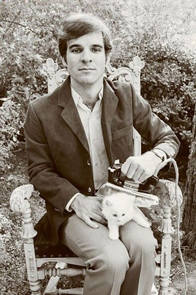 Steve Martin ironing a kitten in the garden