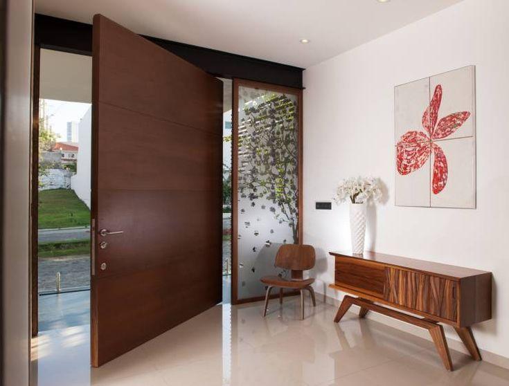 Las 25 mejores ideas sobre puertas principales de madera for Puertas en casas modernas