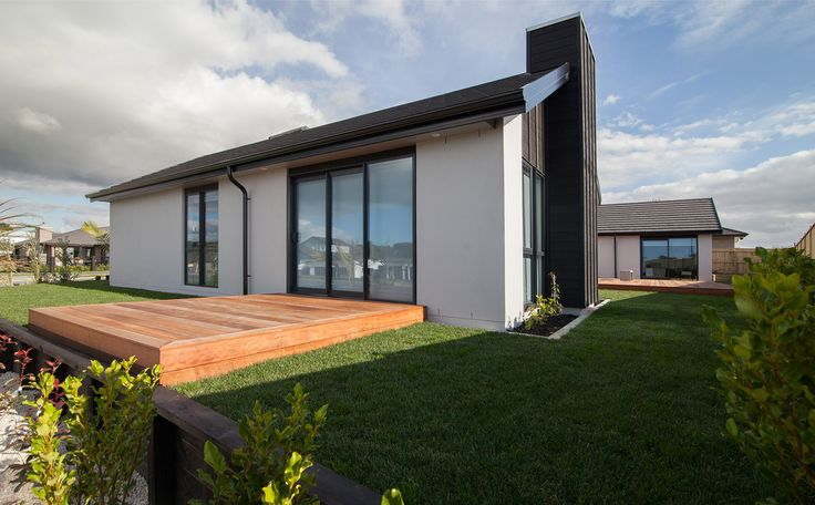 Painted brick forms the majority of this homes exterior, while the feature chimney is clad in weatherboard.