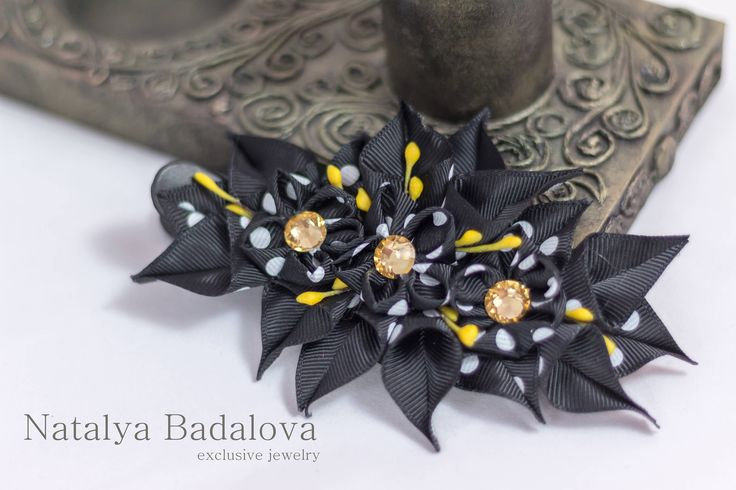 A personal favourite from my Etsy shop https://www.etsy.com/ie/listing/549498196/hair-accessory-kanzashi-flowers-black
