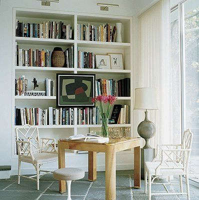 Art in front of bookshelfBookshelves, Dining Room, Hanging Art, Elle Decor, Offices Spaces, Book Nooks, Bookcas, Offices Chairs, Bookshelf Style
