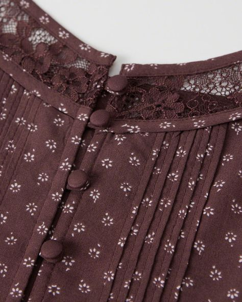 nice example of delicate pin tucks covered buttons and lace insert