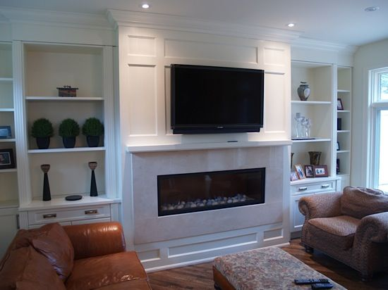 Tv fireplace wall with built ins and moulding trimwork for Living room built ins ideas