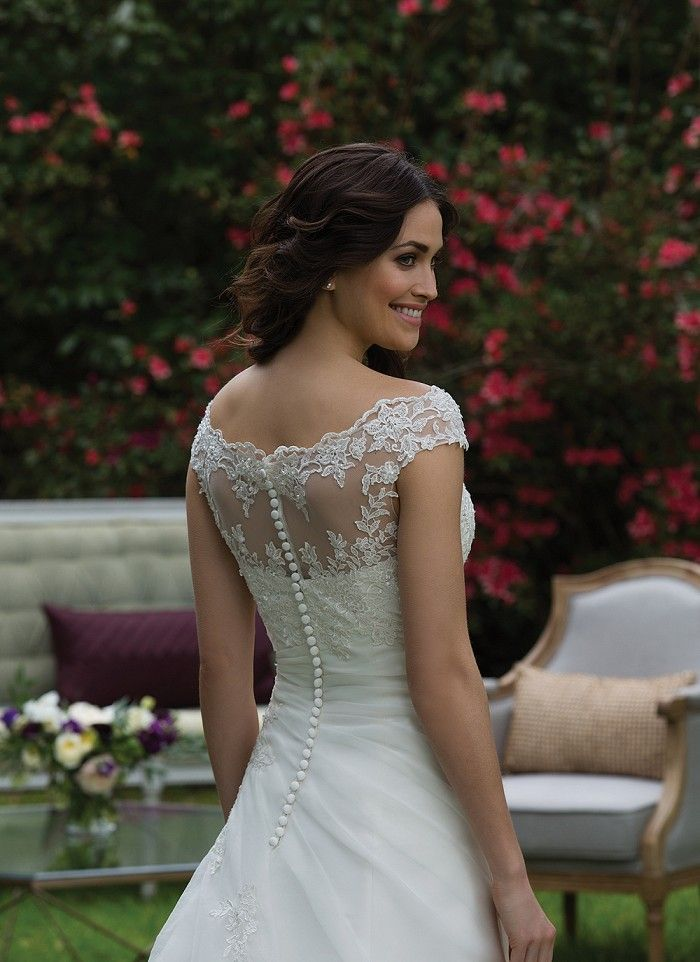 Flatter your figure in this A-line gown featuring a Sabrina neckline, asymmetrical draped natural waistline, and uniquely beaded appliques. https://www.sinceritybridal.com/wedding_dress/3957