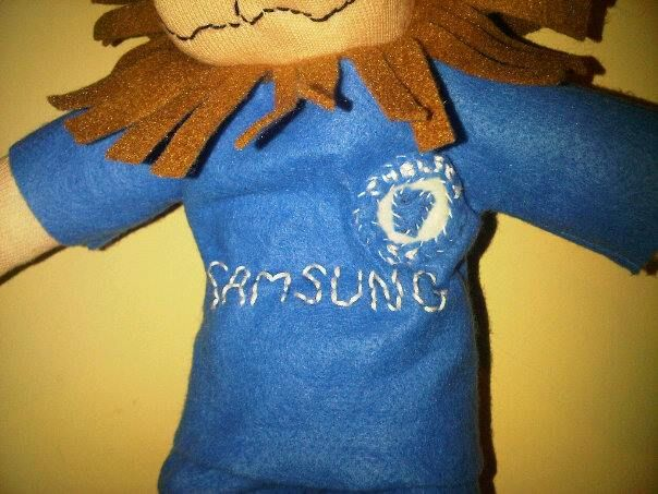 Chelsea badge on Stamford the lion mascot