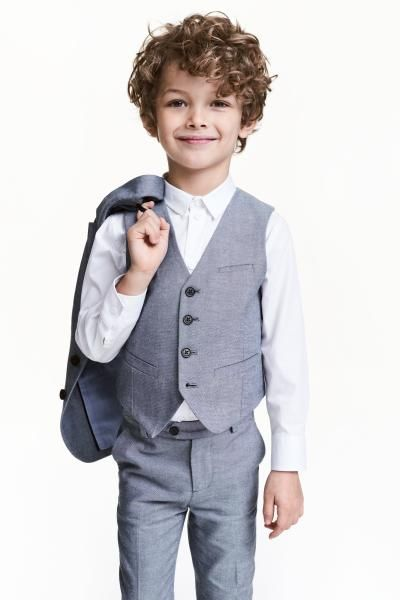 Suit waistcoat: Suit waistcoat in oxford weave cotton with a welt chest pocket, buttons and fake pockets at the front and sewn-on decorative tabs at the back. Lined.
