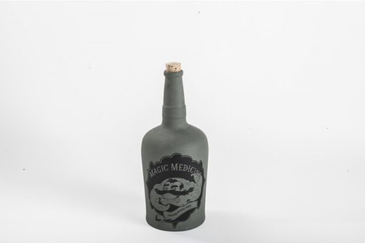 A bottle for tough guys in several dark, matte tones and white glossy version (for a tough guy's missus). It bears the traces of a firm grip and genuine sailor patina. The bottle is glazed inside so it is suitable for all kinds of liquids. It is closable with a cork.  Illustrations by Tomski & Polanski.  Volume- 1.2 litres; material: porcelain/diturvit and cork. Design by Marketa Drzmiskova. www.drzmiskova.cz