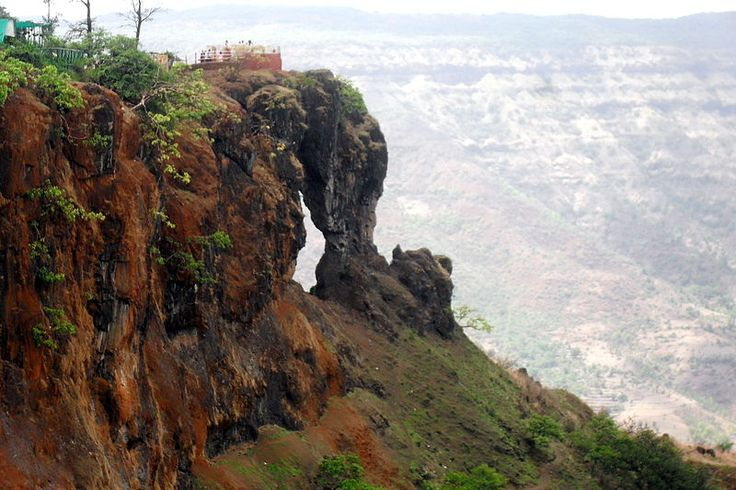 Mahabaleshwar Elephant's Head Point There are several scenic spots in the hills of Mahabaleshwar but Elephant's Head, or Needle Hole Point beats them all. It presents a magnificent panoramic view of the vast expanse of the hills. It is a cliff that has got its name because of this striking resemblance to the elephant trunk and head. Standing over the cliff you can enjoy the breathtaking views of the surrounding hills