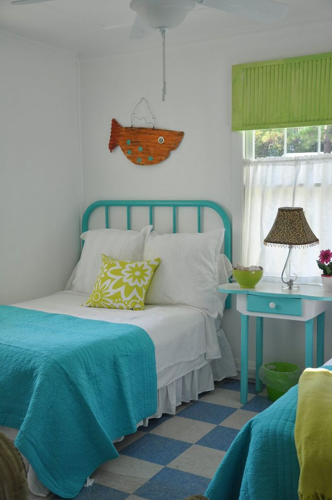 Jane Coslick using VCT tiles in her beach cottages.  Love the cheery colors!