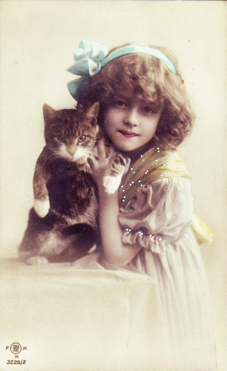 Girl with cat (real photo postcard), ca. 1910s.