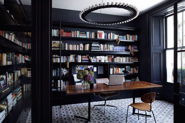 Soft black combined with warm tones of natural wood allow the books spines do the talking!