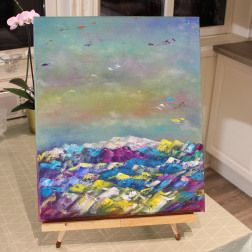 A colourful abstract painting. Rainbow colours. Painted with water soluble oil paint.