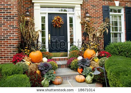 stock photo : Traditional brick colonial dressed up for fall with colorful mums and harvest gourds